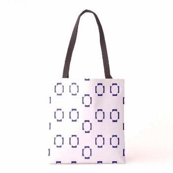 decorative shapes on white tote bag