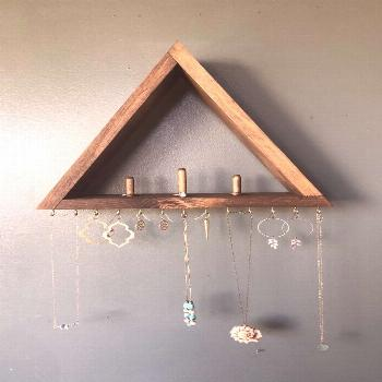 Love this modern take on jewelry wall storage - this could be a really fun DIY jewelry storage proj