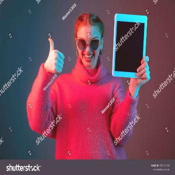 Showing blank tablet screen. Caucasian woman's portrait isolated on gradient studio background in n